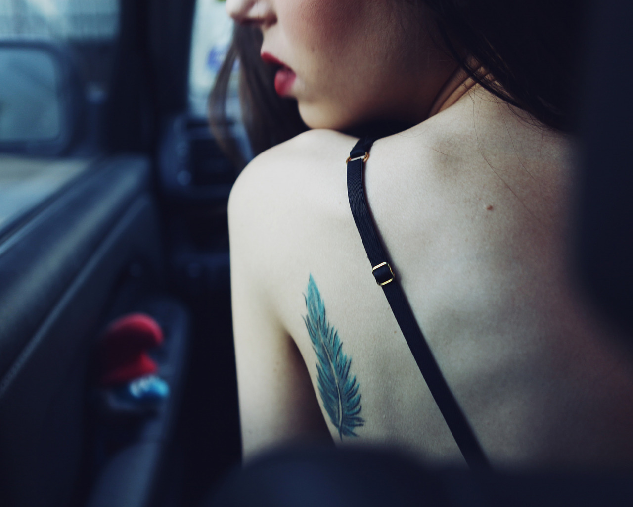 Татуировка в виде пера
