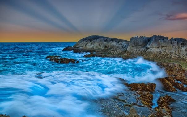 Небо облака закат лучи скалы море