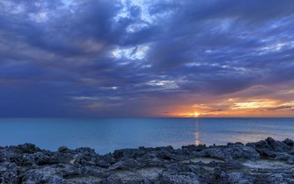 Фото обои море, закат, тучи, камни