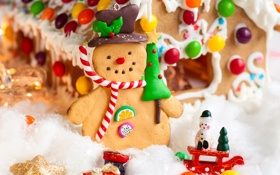 Обои Рождество, Новый год, шоколад, человечек, конфеты, фигурка, новогодняя