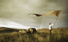 Обои поле, небо, трава, камни, радуга, мужчина, знамя