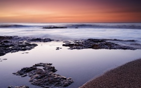 Картинка песок, камни, пляж, рассвет, океан, волна