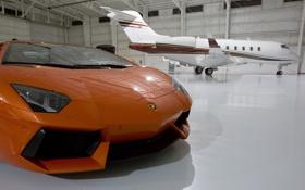 Обои самолёт, оранжевый, передок, тень, orange, ангар, lamborghini