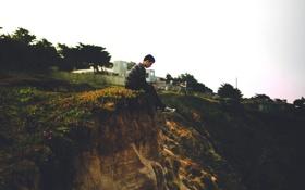 Картинка grass, sky, man, houses, cliff, melancholic