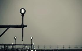 Обои транспорт, фары, забор, аэропорт, серое небо
