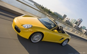Обои boxster, speed, town, yellow, porsche, road