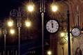 Картинка ночь, город, улица, часы, дома, освещение, фонари
