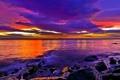 Картинка море, закат, тучи, камни, парусник, фиолетовые