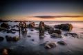 Картинка море, закат, камни, колёса