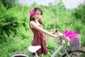 Картинка улыбка, восточная девушка, велосипед, цветы