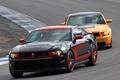 Картинка оранжевый, чёрный, скорость, Mustang, Ford, мустанг, поворот