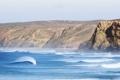 Картинка волны, пляж, небо, брызги, скалы, чайки, серфер