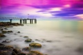 Картинка море, небо, облака, камни, берег, пирс, зарево