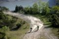 Картинка деревья, озеро, трасса, пыль, гонщики, мотогонки